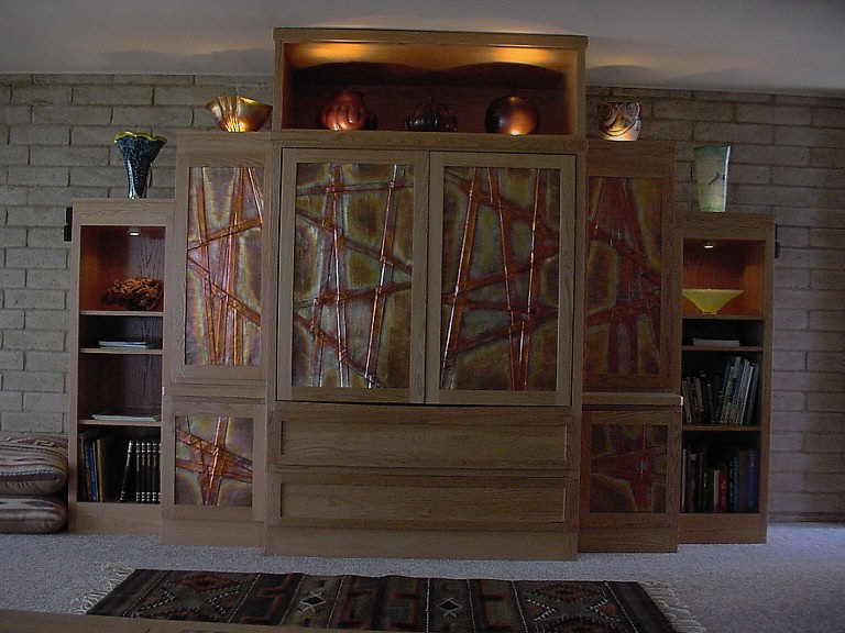 Entertainment Center with custom made copper oxide door panels